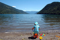 Mountain pool. Toddler enjoying Kootenay lake, British Columbia,canada Stock Images
