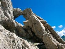 Mountain portal in Romania. Fereastra Zmeilor is a natural portal in detritus rocks in Fagaras mountains (Romania), at 2180 m altitude Royalty Free Stock Image