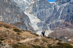 Mountain Porter carrying heavy Luggage on Footpath Stock Images