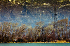 Mountain power lines. Power lines on a mountain and lake backdrop Royalty Free Stock Photo