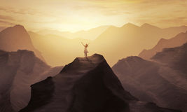 Mountain praise. A woman stands alone on a mountain with her hands in praise royalty free stock photography