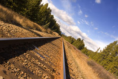 Mountain rails. Railway tracks through the rocky mountains royalty free stock photo