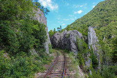 Mountain railway in Romania. A part of the old railway from Oravita to Anina, Romania's oldest and most spectacular mountain railway route, found in Caras royalty free stock photo
