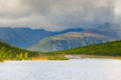 The mountain rain. Rain in the mountain and lake Dancing Grayling Stock Image