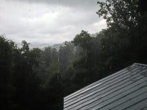 Mountain Rain on a Tin Roof. Rain fall in the Appalachian Mountains outside Asheville, North Carolina Stock Photos