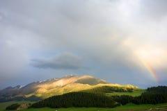 Mountain with rainbow Stock Photos