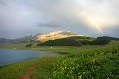 Mountain with rainbow Stock Photo