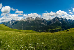Mountain range above Scuol. Wide angle view of mountain range above Scuol, Engadin, Switzerland Stock Photos