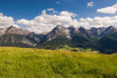 Mountain range above Scuol. Wide angle view of mountain range above Scuol, Engadin, Switzerland Royalty Free Stock Images
