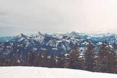 Mountain range in background of ski hill Royalty Free Stock Image