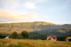 Mountain range bathed Sun Stock Photography