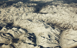 Mountain range, beautiful snowy mountains. View from the airplan Royalty Free Stock Photos