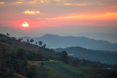 Mountain range and beautiful sunset. Layers of mountain range and beautiful sunset sky, natural environment background Stock Photos