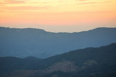 Mountain range and beautiful sunset. Layers of mountain range and beautiful sunset sky, natural environment background Stock Images