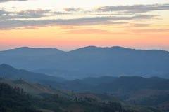Mountain range and beautiful sunset. Layers of mountain range and beautiful sunset sky, natural environment background Stock Image