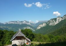 Mountain range in the Chartreuse. A barn with a beautiful view of the Chartreuse, a regional nature park situated near Grenoble royalty free stock image