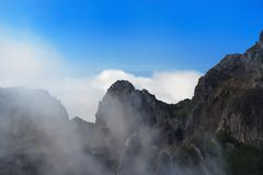 Mountain range in the clouds. Portuguese island of Madeira. Mountain range in the clouds. View from Pico do Arieiro on Portuguese island of Madeira royalty free stock photos