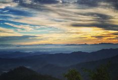 Mountain range in cloudy sunset time. Beautiful landscape in Thailand Stock Image