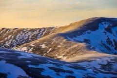 Mountain range with colourful sunset. Mountain range with colourfull sunset at winter Stock Images