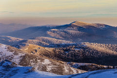 Mountain range with colourful sunset. The Mountain range with colourful sunset at winter Stock Photo