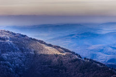 Mountain range with colourful sunset. The Mountain range with colourful sunset at winter Stock Image