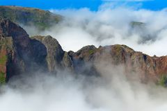 Mountain range in dense clouds. View from Pico do Arieiro on Madeira. Mountain range in dense clouds. View from Pico do Arieiro on Portuguese island of Madeira royalty free stock image