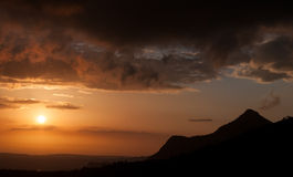 Mountain range and dramatic sky during sunset Royalty Free Stock Images
