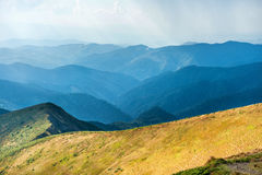 Mountain range with dry yellow grass Stock Photography