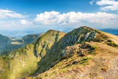 Mountain range with dry yellow grass Stock Photos