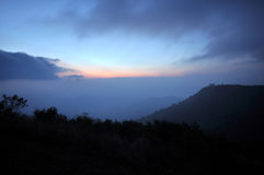Mountain range of fog at daybreak Royalty Free Stock Images