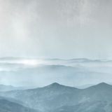 Mountain range in the fog - horizon background in grey blue vintage style Stock Images