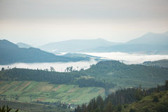 Mountain range with fog in the valley Royalty Free Stock Photo