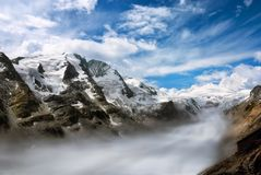 Mountain range with fog in the valley Stock Image