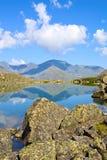 Mountain Range and Glacial Lake. Mountain  Range with  its  Reflection in the Glacial Lake, altai, siberia, Russia Stock Photo