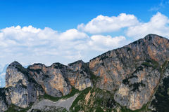 Mountain range high mountains peaks bright blue sky with clouds. Alps, Austria Royalty Free Stock Photo