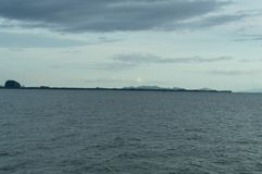 Mountain range and island. In the sea Stock Photography