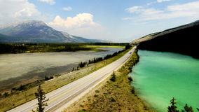 Mountain Range landscape, Rocky Mountains, Canada. Rocky Mountains, Canada. Mountain range landscape. Green lake and highway view. Canadian Rockies, National stock images