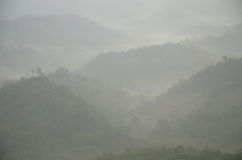 Mountain range with mist in the morning Stock Photography