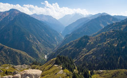 Mountain range in National Park in Kazakhstan. Almaty, Talgar. Image of summits at autumn with aerial view Stock Photo