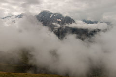 Mountain range obscured by clouds Royalty Free Stock Photography