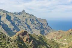 Mountain range on the ocean coast Stock Photography