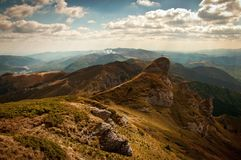 Mountain range and person on top Royalty Free Stock Image