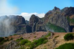 Mountain range on Pico do Arieiro against blue sky. Madeira. Mountain range on Pico do Arieiro against blue sky. Portuguese island of Madeira royalty free stock photography