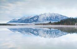 Mountain range reflected in Barmsee lake Stock Photos