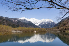 Mountain Range reflected in lake Stock Image