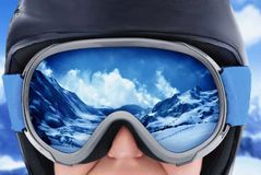 A Mountain Range Reflected in the Ski Mask. Girl wearing a ski mask Stock Photos