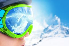 A mountain range reflected in the ski mask.Shallow depth of field.Ski mask. A mountain range reflected in the ski mask.Shallow depth of field Royalty Free Stock Photography