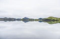 Mountain range reflecting in a lake Stock Photos