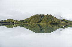 Mountain range reflecting in a lake Stock Images
