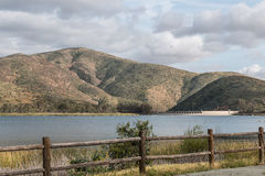Mountain Range, Reservoir, Lake and Fence Stock Image